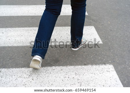 Crossing the road at a pedestrian crossing, safety #659469154