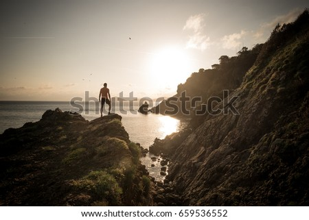 Man hiking on a mountain over the sea #659536552