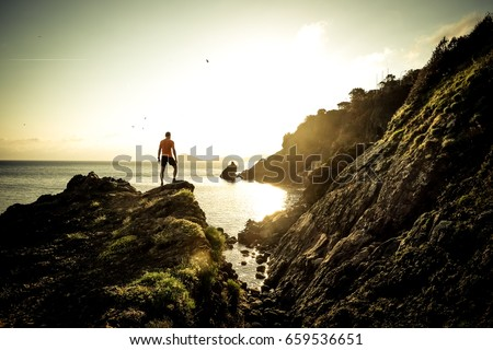Man hiking on a mountain over the sea #659536651