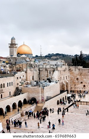 Jerusalem, Israel - March 24, 2011: View of the Western Wall, the Dome of the Rock and the Mughrabi Gate on the Temple Mount in the Old City of Jerusalem.  #659689663