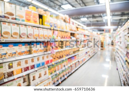 Blur selection of alternative milks, chocolate & bulk candies, jam, nut butter, hot, cold cereal on shelves in store at Houston, Texas, US. Defocused of aisles, row, variety product. Customer shopping #659710636