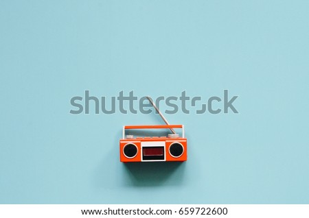 Top view of miniature vintage radio and tape recorder on blue color background,copy space  #659722600