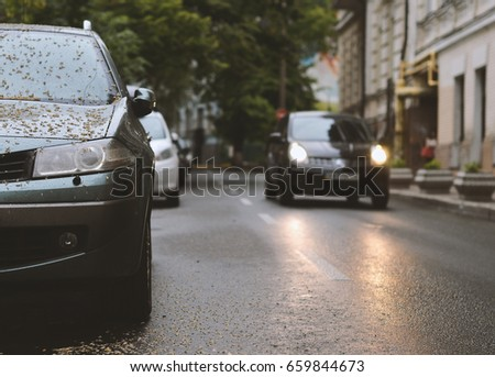 parked car in during rain #659844673