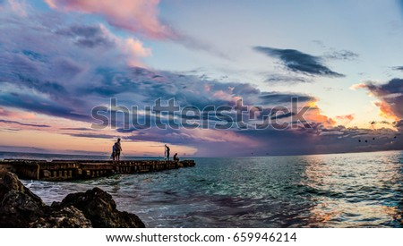 Sunset over the old broken pier on Siesta Key, Florida #659946214