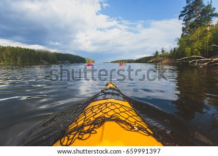 A process of kayaking in the lake skerries, with colorful canoe kayak boat paddling, process of canoeing, vibrant summer picture