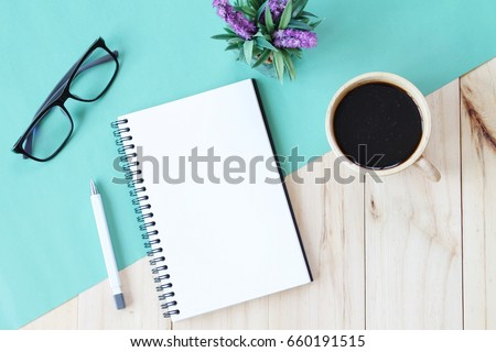 Still life, business, office supplies or education concept : Top view image of open notebook with blank pages and coffee cup on wooden background, ready for adding or mock up Royalty-Free Stock Photo #660191515