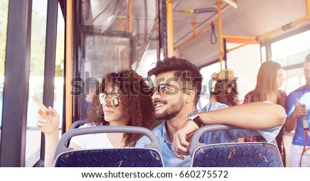 Smiling young couple in a bus. #660275572
