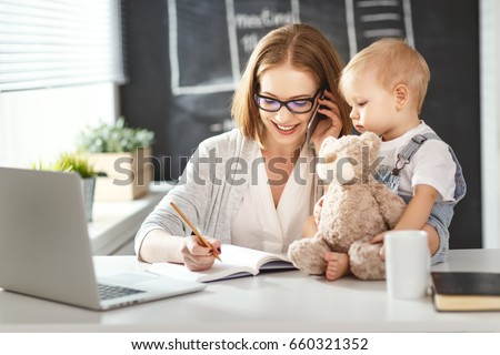 Businesswoman mother  woman with a toddler working at the computer #660321352