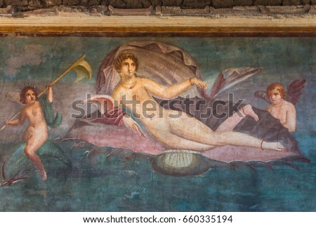 A fresco Venus in the shell in ruins of Ancient Roman city Pompeii, Campania region, Italy. City destroyed by eruption of Mount Vesuvius. Wall fresco in House of Venus depicts goddess and two Cupids.