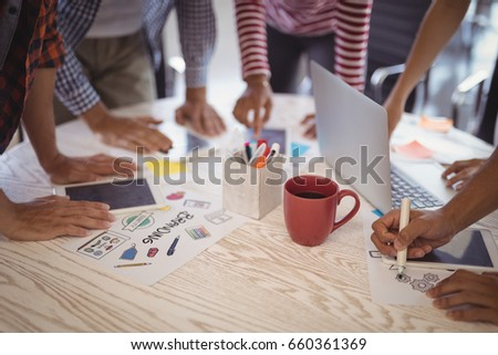 Business people working together on creative office desk #660361369