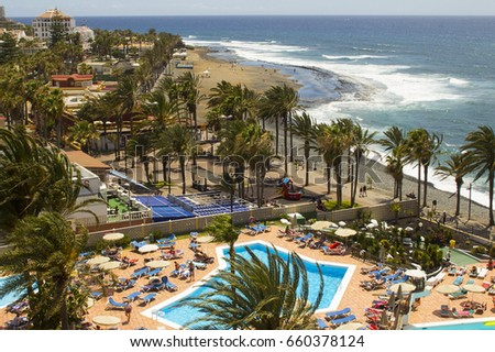 10 May 2017 A view from a hotel Balcony across the sunny beach and bay at Playa Las Americas in Teneriffe in the canary Islands #660378124