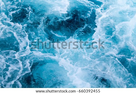 Sea water ship trail with foamy wave. Tropical islands ferry travel. Cruiseliner seawater trail. Deep ocean top view. Big ship pitching image. White swirl wave in sea. Marine travel banner template #660392455