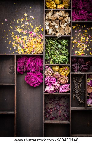wooden background with dry roses #660450148
