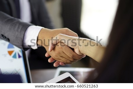 business man shake hands with business woman  #660521263