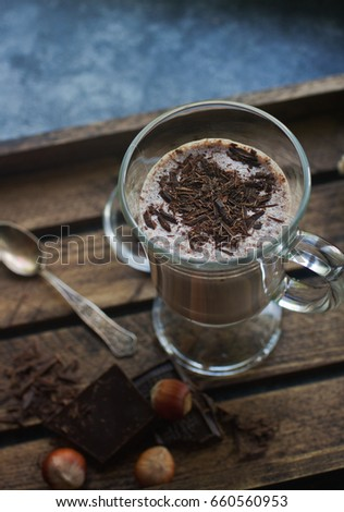 Homemade chocolate milk shake in glasses on wooden background, selective focus. Delicious dessert #660560953