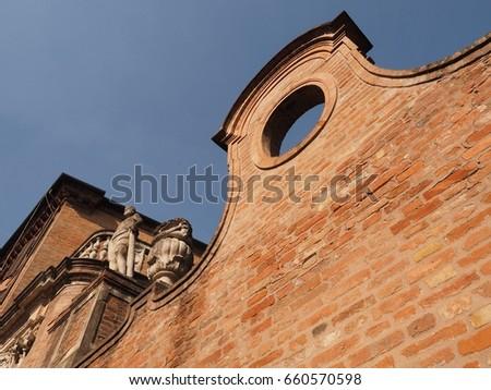 Ferrara, Italy. Ancient embattled wall. #660570598