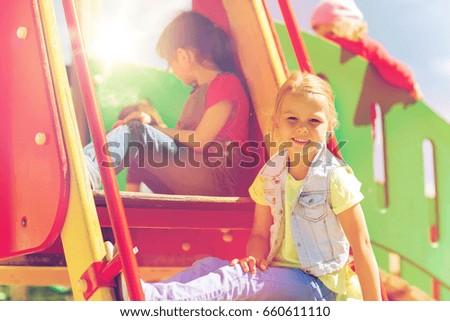 summer, childhood, leisure, friendship and people concept - happy kids on children playground climbing frame #660611110