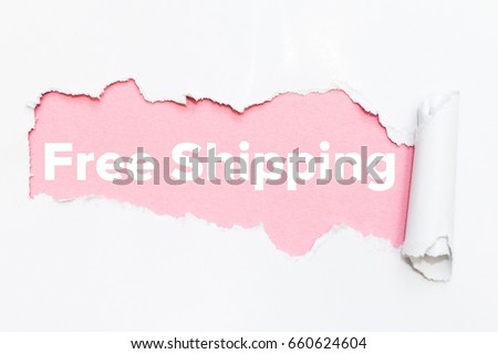 Pink hole in white paper. Free shipping. Royalty-Free Stock Photo #660624604