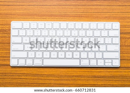 Keyboard on wooden background #660712831