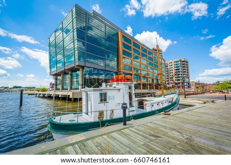 Boat and modern building along the waterfront in Fells Point, Baltimore, Maryland. #660746161