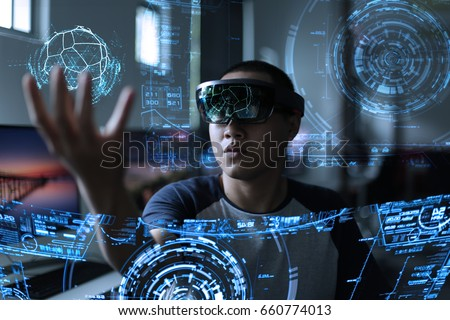 Men playing virtual reality with hololens Royalty-Free Stock Photo #660774013