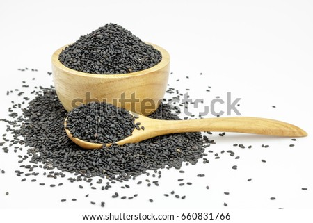 Black Sesame Seeds  in wooden bowl and spoon on white background. Composition isolated over the white background. #660831766