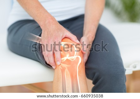 Digitally composite image of man suffering with knee cramp  Royalty-Free Stock Photo #660935038