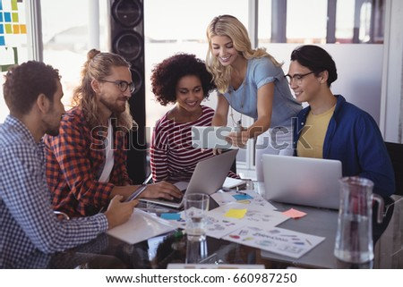 Young business team working together at creative office desk #660987250