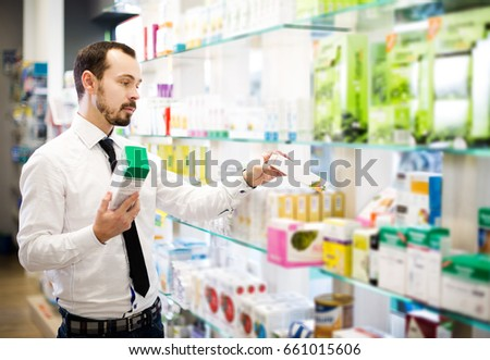Adult customer searching for reliable drug in pharmacy #661015606