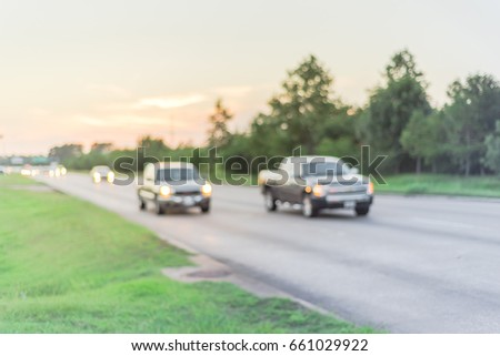 Blurred image of traffic and defocused bokeh lights at rush hour during sunset. Out of focus traffic in afternoon rush hour at Humble, Texas, US. Line of cars at peak travel time. Urban infrastructure #661029922