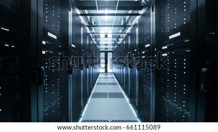 Shot of Corridor in Working Data Center Full of Rack Servers and Supercomputers. #661115089