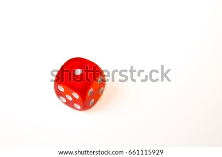 A single red die showing a one on the upper face, isolated against a white background #661115929