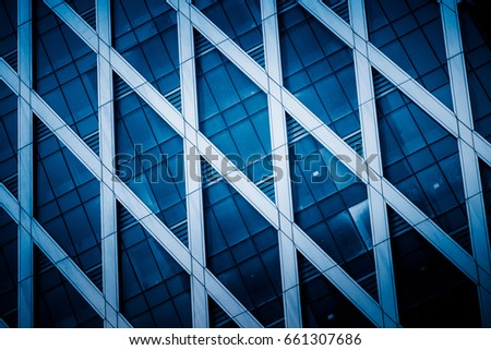 detail shot of modern architecture facade,business concepts in blue tone,shot in city of China. #661307686