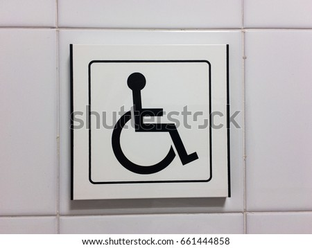 Disabled icon on tiles of a hospital bathroom #661444858