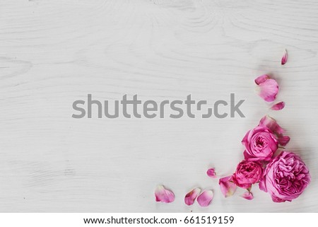 Roses frame on white wooden background #661519159