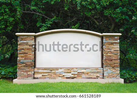 Stone sign marker with blank center panel for customized message