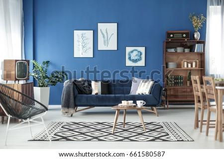 Living room view in stylish retro elegant apartment #661580587