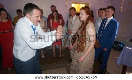 Kursk, Russia - June 3, 2017 beautiful weddingcouple and friends #661645759