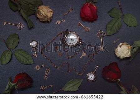 Roses,  pocket watch and old key. Vintage Wonderland background