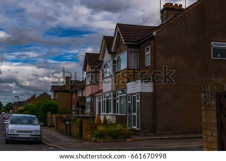 Typical old English buildings, low brick buildings across a narrow street, interesting old London architecture, english houses #661670998