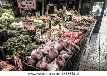 Photograph looking down table at a vegetable stand in Pike Place market in downtown Seattle Washington