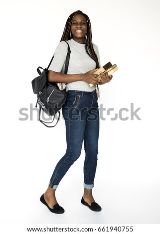 Young student girl holding school textbook #661940755