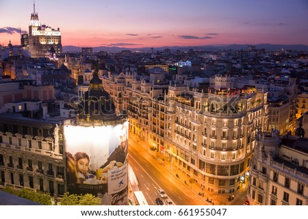 Madrid, Spain - September 29 2015: The sunset view of commercial buildings on Gran Via, where busiest street in the city. #661955047