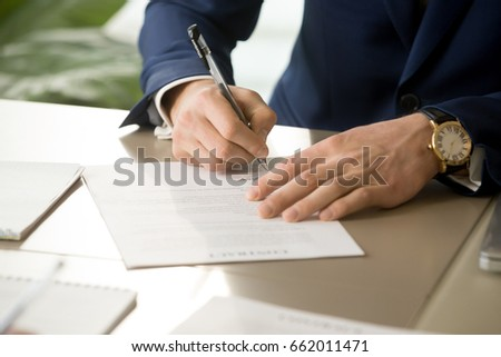 Businessman having signatory right signing contract concept, focus on male hand putting signature on official legal document, entering into commitment, concluding business agreement, close up view #662011471