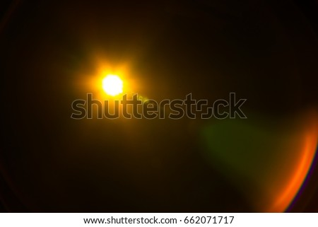The warm color natural lens flare pattern with light rays #662071717