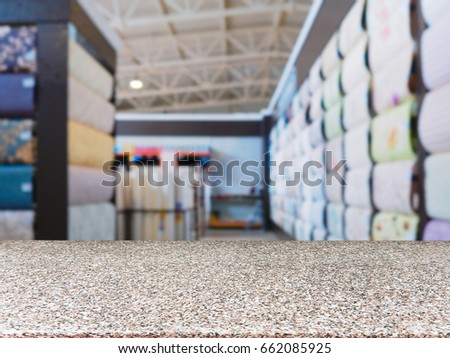 Marble empty table in front of blurred DIY supermarket background. Mock up for display of product. #662085925