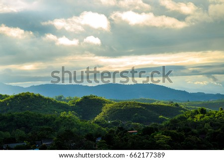 Sunset in the evening with beam on the Mountain  #662177389