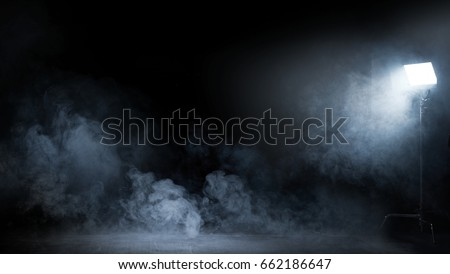 Conceptual image of a dark interior full of swirling fume