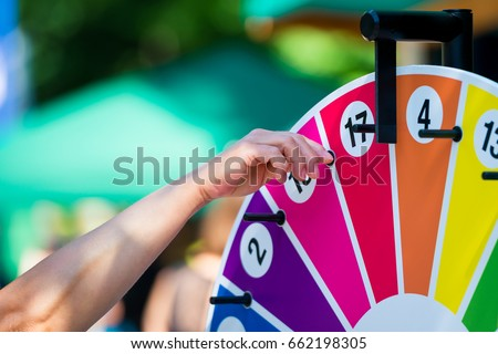 Wheel of fortune turning on a children's festival Royalty-Free Stock Photo #662198305