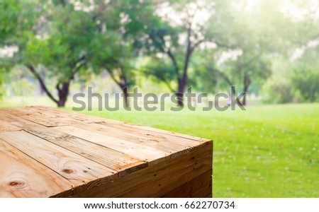 Empty wood plank table food stand with blur tree in park bokeh light background,Template mock up for display or montage of product #662270734